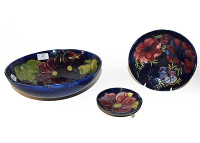 Lot 48 - Three Moorcroft bowls, Cobalt blue ground, Clematis and Anemone pattern, the largest 26.5cm...