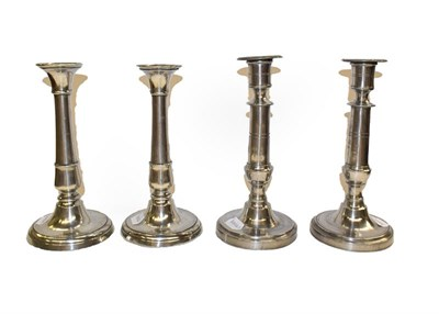 Lot 65 - A pair of 19th century pewter ejector candlesticks of cannon barrel form, together with another...
