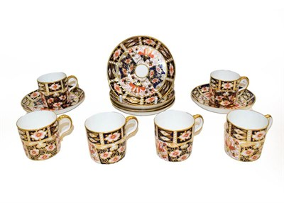 Lot 68 - A set of six Royal Crown Derby coffee cups and saucers in Imari 2451 pattern, date code 1930