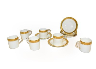 Lot 71 - A set of six Royal Worcester coffee cans and saucers decorated with gilt and scrolling, date...