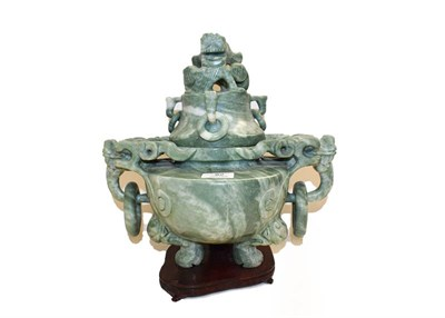 Lot 82 - A 20th century Chinese green hardstone vase and cover, with twin ring and mask handles on...
