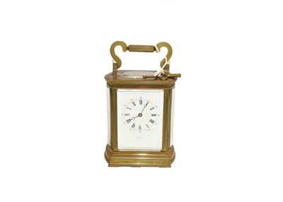 Lot 89 - A 19th century brass cased carriage clock striking on a gong, with bowed sides and having...