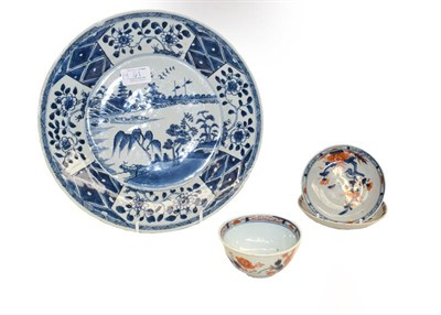 Lot 91 - An 18th century Chinese blue and white dish painted with a river landscape, together with an...