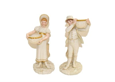 Lot 94 - A pair of Royal Worcester figures of a boy and a girl holding a basket, reclined against a tree...