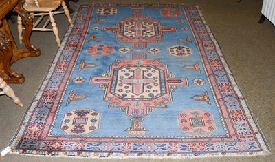 Lot 1003 - An Isparta rug, the sky blue field with two cruciform medallions enclosed by Kufic borders,...