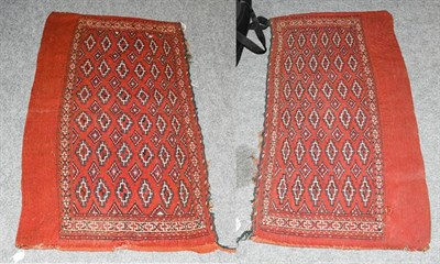 Lot 1004 - A pair of Yomut Chuvals, each with a madder field of thirty-six güls enclosed by narrow ivory...