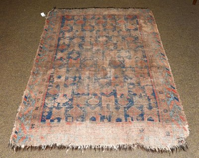 Lot 1007 - An Afshar rug, the indigo field with columns of geometric devices enclosed by serrated leaf and...