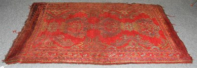 Lot 1011 - An Ushak Rug, the tomato red field with three medallions enclosed by multiple narrow borders, 245cm