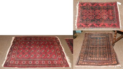 Lot 1013 - An Afghan Tekke rug, the crimson field with four rows of güls enclosed by octagon borders,...