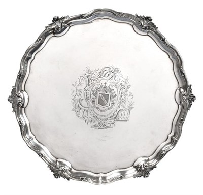 Lot 2003 - A George II Silver Salver, by George Wickes, London, 1754, shaped circular and on three cast...