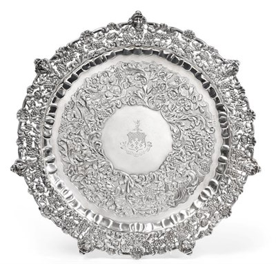 Lot 2024 - A William IV Irish Silver Salver, by James Moore, Dublin, 1835, shaped circular and on four foliage