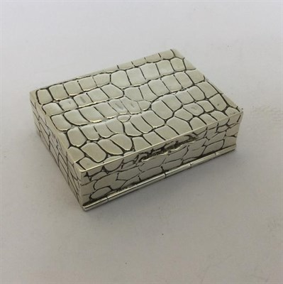 Lot 2060 - An Edward VII Silver Box, by Lawrence Emanuel, Birmingham, 1901, oblong and with textured...