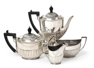 Lot 2064 - A Four-Piece Victorian Silver Tea and Coffee-Service, by Walter and John Barnard, London, 1890...