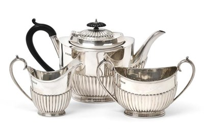 Lot 2065 - A Three-Piece Edward VII Silver Tea-Service, by Cooper Brothers and Sons Ltd., Sheffield, 1908,...