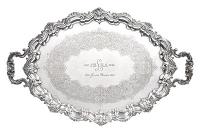 Lot 2083 - An Edward VII Silver Tray, by Barker Brothers, Birmingham, 1904, shaped oval and on four...
