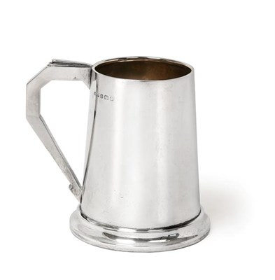 Lot 2086 - A George V Silver Mug, by Hukin and Heath Ltd., Birmingham, 1935, tapering cylindrical and on...