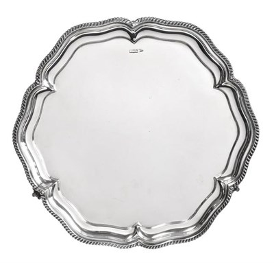 Lot 2096 - A George V Silver Salver, by Walker and Hall, Sheffield, 1915, shaped circular and on three...