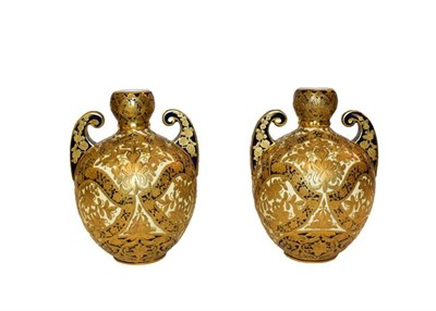 Lot 9 - Royal Crown Derby: A pair of gilt twin-handled vases, 18cm high