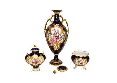 Lot 21 - Royal Crown Derby: A gilt and cobalt blue twin-handled covered vase painted with floral sprays...