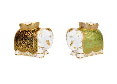 Lot 29 - Royal Crown Derby Paperweights: A group of six elephants all with gold stoppers, tallest 11cm