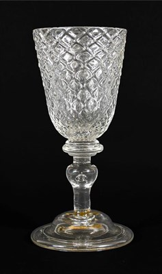 Lot 9 - A Glass Goblet, circa 1730, the rounded funnel bowl moulded with ''Nipt diamond waies'' on a triple