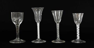 Lot 19 - A Wine Glass, circa 1750, the rounded funnel bowl on a mercury twist stem, 15.5cm high; A Wine...