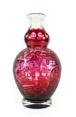 Lot 25 - A Bohemian Cranberry Overlaid Clear Glass Vase, 20th century, of double gourd form, etched and...