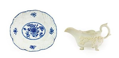 Lot 33 - A Bow Porcelain Sauceboat, circa 1755, of oval form with leaf sheathed handles, moulded and applied