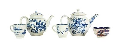 Lot 34 - A Bow Porcelain Teapot and Cover, circa 1760, printed in underglaze blue with sprays of flowers and