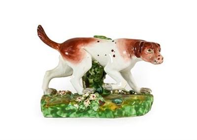 Lot 58 - A Derby Porcelain Figure of a Hound, circa 1790, on a mound base, 16.5cm long