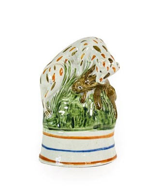 Lot 75 - A Pratt Type Stirrup Cup, circa 1800, as a hound catching a hare on a grassy mound and blue and...