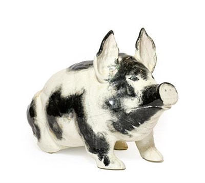 Lot 92 - A Wemyss Pottery Pig, early 20th century, naturalistically modelled seated, with black sponged...