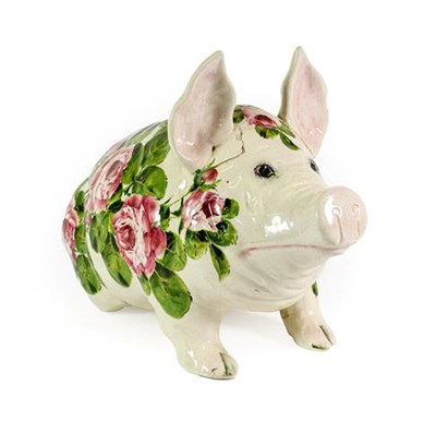 Lot 94 - A Wemyss Pottery Pig, early 20th century, naturalistically modelled seated, painted with pink...