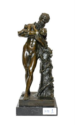 Lot 221 - After the Antique: A Bronze Figure of Silenus, standing beside a tree trunk holding Bacchus as...