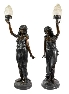 Lot 229 - A Pair of French Bronze Figural Torcheres, early 20th century, as classical maidens standing...
