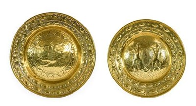 Lot 243 - A Nuremberg Brass Alms Dish, 16th/17th century, repoussé with Joshua and Caleb returning from...