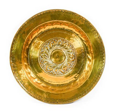 Lot 247 - A Nuremberg Brass Alms Dish, 17th century, the central gadrooned boss within foliate bands,...