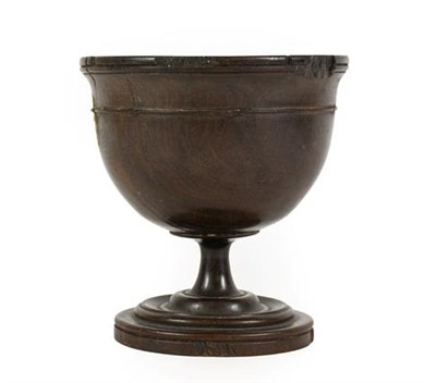 Lot 268 - A Lignum Vitae Pedestal Cup, 18th century, the ovoid bowl with reeded rim and turned band on a...