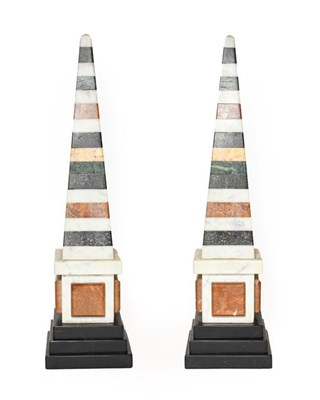 Lot 270 - A Pair of Specimen Marble Obelisks, in George III style, on stepped square slate bases, 49cm high