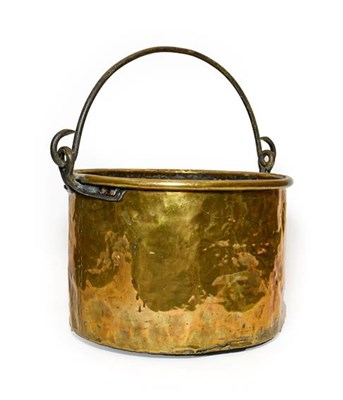 Lot 271 - A Brass Log Bin, possibly Irish, 18th/19th century, of circular form with rolled rim and iron swing