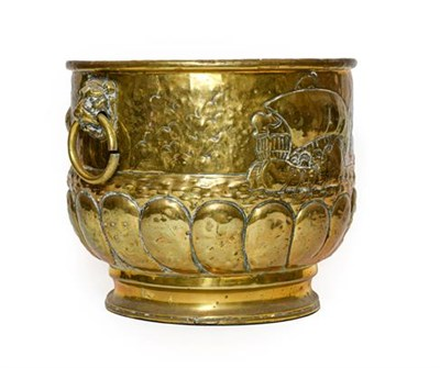 Lot 272 - A Dutch Brass Log Bin, late 19th/early 20th century, of cylindrical form with mask and ring handles