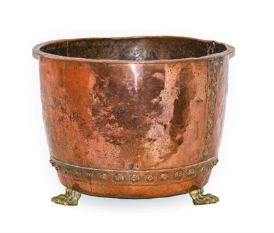 Lot 274 - A Brass and Copper Log Bin, 19th century, of circular form with everted rim, on paw feet, 54cm...