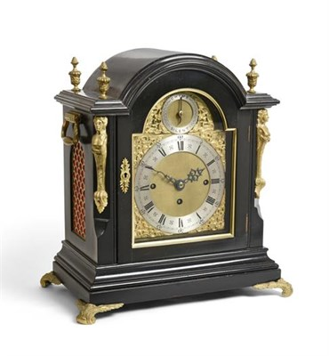 Lot 285 - A Victorian Ebonised Chiming Table Clock, circa 1880, arched pediment with urn shaped finials, fish