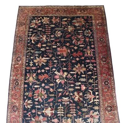 Lot 297 - Oriental Carpet of Heriz Design, 2nd half 20th century The indigo field with an allover design...