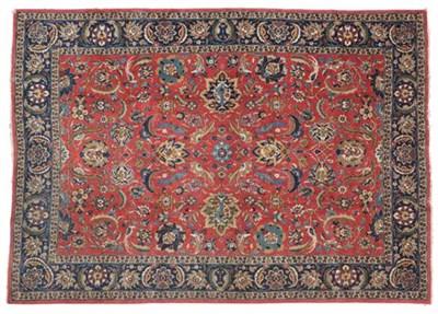 Lot 299 - Tabriz Carpet  Iranian Azerbaijan, circa 1940 The deep terracotta field of vines and birds enclosed