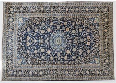 Lot 301 - Kashan Carpet Central Iran, circa 1970 The indigo field of palmette and vines around a...
