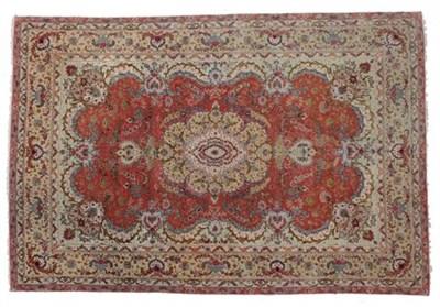 Lot 302 - Very Fine Tabriz Carpet North West Iran, circa 1990 The bright terracotta field centred by a...