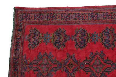 Lot 303 - Ushak Carpet West/Central Anatolia, circa 1920 The tomato red field with three rows of...