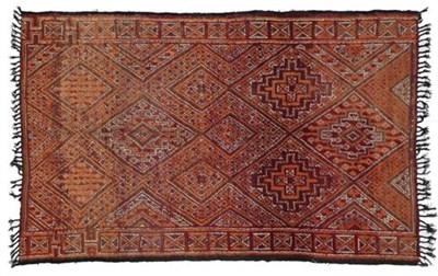 Lot 307 - Moroccan Village Rug, circa 1970 The pale aubergine diamond lattice field containing stepped...