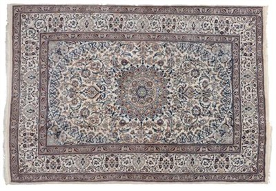 Lot 308 - Nain Carpet Central Iran circa 1960 The ivory field of foliate, large serrated leaves around a...